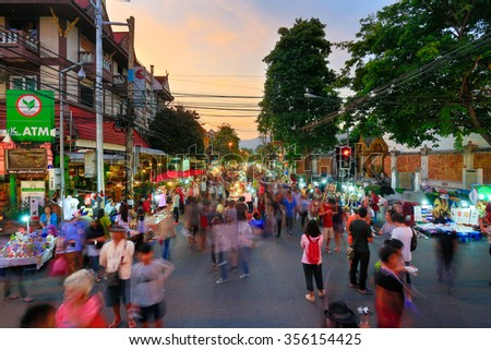 CHIANG MAI THAILAND - DECEMBER 20 : Sunday market walking street, The city center Thai temple marketing and trading of local tourists come to buy souvenirs. on Dec 20, 2015 in Chiang Mai, Thailand. - stock photo