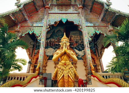 CHIANG MAI, THAILAND - FEB 25: Praying Buddha statue standing at entrance of ancient Buddhist temple structure on February 25, 2016. King Mengrai founded the city of Chiang Mai in 1296 - stock photo