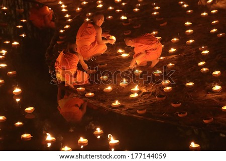 CHIANG MAI THAILAND-FEBRUARY 14 : Vesak Day.Traditional buddhist monks are lighting candles for religious ceremonies at Wat Phan Tao temple.on FEB. 14,2014 in Chiangmai,Thailand