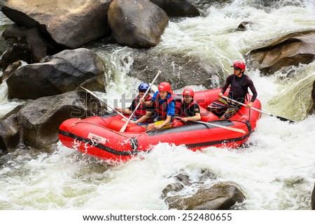 CHIANG MAI, THAILAND - FEBRUARY 6 : White water rafting on the rapids of river Maetang on FEBRUARY 6, 2015 in Chiang Mai, Thailand.  Maetang river is one of the most dangerous rivers of Thailand. - stock photo