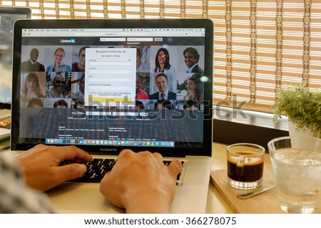 CHIANG MAI ,THAILAND, JAN 23 2016 : CHIANG MAI ,THAILAND, JAN 23 2016 : Apple Macbook pro with page social network service LinkedIn on the screen.  - stock photo