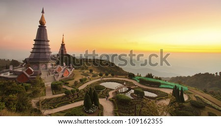 CHIANG MAI, THAILAND - JAN 02: People pray for a religious ceremony in the Doi Inthanon during the New year festival in Chiang Mai, Thailand on Jan 02, 2012. - stock photo