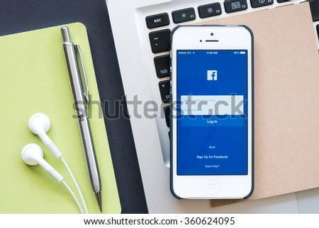 CHIANG MAI, THAILAND - JAN 09,2016: The Facebook iOS application is launching on iPhone. The login screen is showing. Facebook is the social network application that connects people together online. - stock photo
