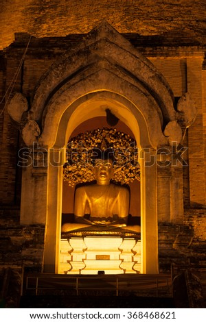 CHIANG MAI,THAILAND-JANUARY 16,2016 :Golden sitting Buddha on pagoda in Wat Chedi Luang (Temple of the Big ) is an impressive ruined temple in the center of Chiang Mai Province,Northern Thailand.Stupa - stock photo
