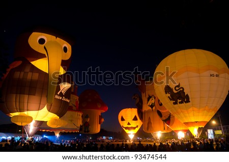 CHIANG MAI, THAILAND - JANUARY 21: Hot air balloons get ready to take flight at the Chiangmai International Balloon Fiesta 2012 in Chiangmai, Thailand on January 21, 2012. - stock photo