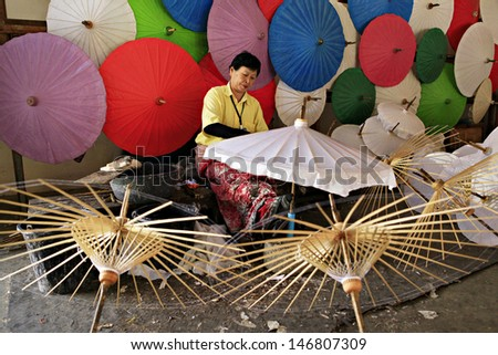 CHIANG MAI, THAILAND-JANUARY 20 : 30th anniversary Bosang umbrella festival,Women in traditional costume during the annual Umbrella festival at San Kamphaeng. on Jan.20, 2013 in Chiang Mai, Thailand.