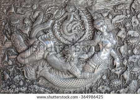 CHIANG MAI, THAILAND - JANUARY 17 : The traditional Thai style handmade silver metal carving on the wall in Wat Sri Suphan on January 17, 2016 in Chiang Mai, Thailand.