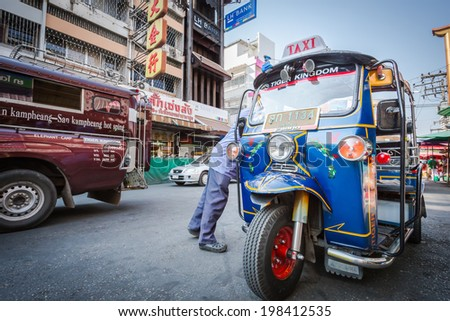 CHIANG MAI, THAILAND- January 17 : Tuk Tuk is parking on the street with unidentified driver in the market in Chiang Mai in Thailand on 17 January 2013 - stock photo