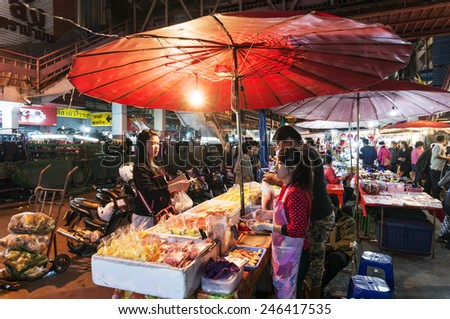 CHIANG MAI THAILAND - JANUARY 13 : Warorot Market, Popular tourist food and visit the local fruit market is be held everyday. on January 13 , 2015 in Chiang Mai, Thailand. - stock photo