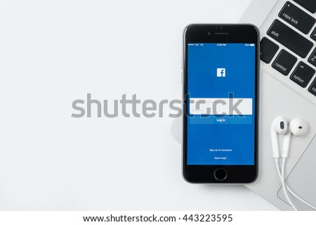 CHIANG MAI, THAILAND - Jun 24,2016: he Facebook iOS application is launching on iPhone. The login screen is showing. Facebook is the social network application that connects people together online. - stock photo
