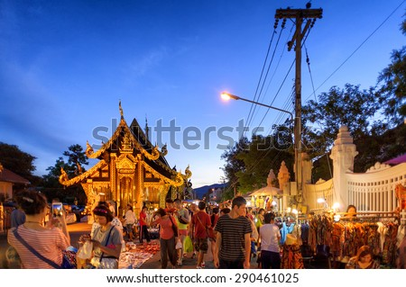 CHIANG MAI THAILAND - JUNE 7 : Sunday market walking street, The city center Thai temple marketing and trading of local tourists come to buy as souvenirs. on June 7, 2015 in Chiang Mai, Thailand. - stock photo