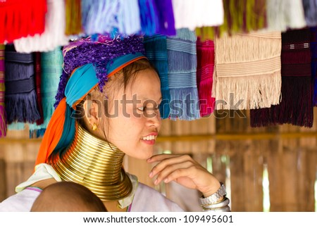 CHIANG MAI, THAILAND - JUNE 13: Unidentified Karen tribe woman poses for the camera in Chiang Mai on June 13, 2012. The Karen people wear brass rings around their neck from as young as five years old.