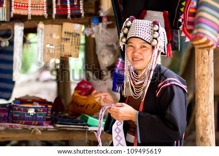 CHIANG MAI, THAILAND - JUNE 13: Unidentified Karen tribe woman poses for the camera in Chiang Mai on June 13, 2012. The Karen people wear brass rings around their neck from as young as five years old. - stock photo
