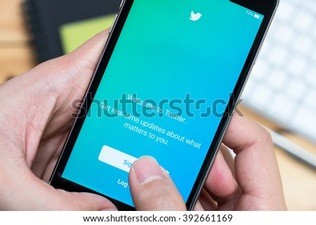 CHIANG MAI, THAILAND - MAR 12,2016: Apple iPhone with Twitter application on the screen. Twitter is an online social networking service for users to send and read short 140-character messages.