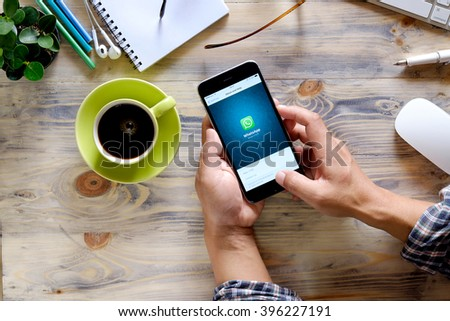 CHIANG MAI,THAILAND - MAR 26, 2016 : Man holding a iPhone 6 plus with social Internet service WhatsApp on the screen. iPhone 6 plus was created and developed by the Apple inc.  - stock photo