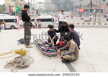 Chiang Mai, Thailand - March 25, 2016: Paramedic and stretcher gurney in mock disaster drill at Maya shopping center in Chiang Mai, Thailand on March 25, 2016. - stock photo