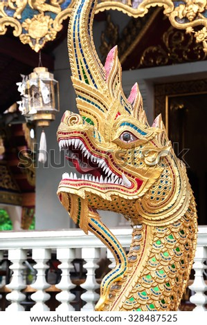 CHIANG MAI, THAILAND - MARCH 11, 2015 - Phaya Naga serpent at Wat Pra Singh, Chiang Mai, Thailand. Naga are seen as protectors and are often seen at the entrances to temples around South East Asia.
