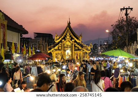 CHIANG MAI THAILAND - MARCH 8 : Sunday market walking street, The city center Thai temple marketing and trading of local tourists come to buy as souvenirs. on March 8 , 2015 in Chiang Mai, Thailand. - stock photo