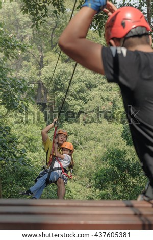 CHIANG MAI, THAILAND -MARCH 13: Tourist on a zip line, An activity in a hill on March 13,2016. It is one of the signatures of Chiang Mai.