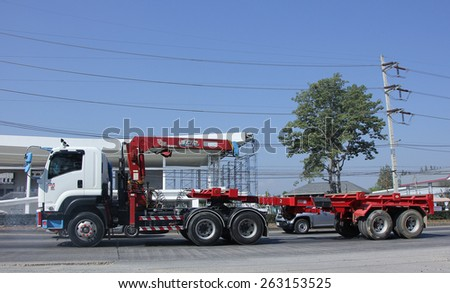 CHIANG MAI, THAILAND - MARCH 5 2015:  Trailer Truck with Crane of Chiangmai PK Transport.  Photo at road no.1001 about 8 km from downtown Chiangmai, thailand. - stock photo