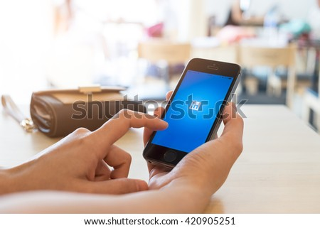 CHIANG MAI, THAILAND - May 15,2016: Hand of man holding a Apple iPhone with LinkedIn application on the screen. LinkedIn is a business-oriented social networking service.
