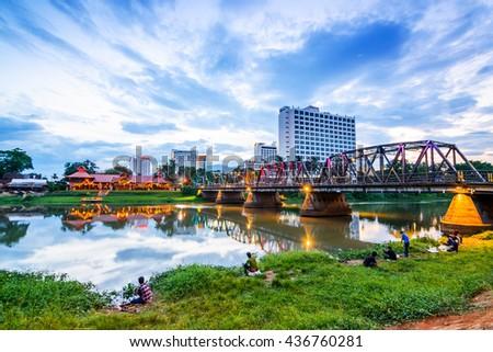 CHIANG MAI, THAILAND - MAY 19, 2016: Night view of the old iron bridge, Chiang Mai, thailand. - stock photo