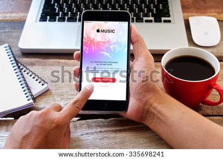 CHIANG MAI,THAILAND - NOV 05 ,2015  Apple music app showing on iPhone 6 plus in his office. Apple Music is the new iTunes-based music streaming service that arrived on iPhone - stock photo