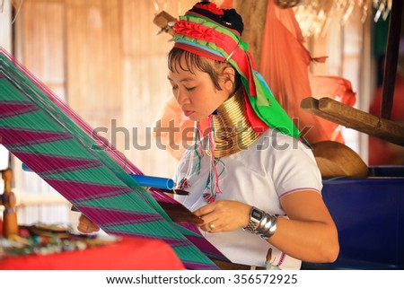 Chiang Mai, Thailand - Nov 27, 2015: Unidentified Karen Long Neck woman in traditional hill tribe village also known as Kayan indigenous ethnic group. Famous tourist travel destination. - stock photo