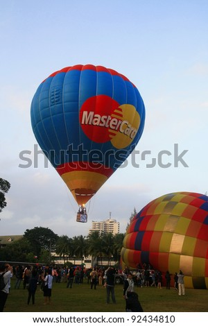 CHIANG MAI, THAILAND - NOV 26:Unidentified participant blows up their balloons in the Thailand International Balloon Festival on November 26,2011 at Prince Royal's College in Chiang Mai Thailand.