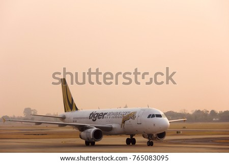 Chiang Mai, Thailand - November 29, 2017 : low cost airline tiger airway on the runway and ready to departure in the sunset time at Chiang Mai airport, Thailand