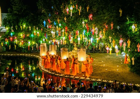 CHIANG MAI THAILAND-NOVEMBER 7 : Loy Krathong festival in Chiangmai.Traditional monk lights floating balloon made of paper annually at Wat Phan Tao temple.On November 7,2014 in Chiangmai,Thailand.  - stock photo