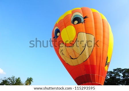 CHIANG MAI, THAILAND - NOVEMBER 26, 2011: Unidentified hot air balloons participate in the 2011 Thailand International Balloon Festival in Chiangmai, Thailand on November 26, 2011.