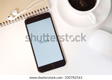 CHIANG MAI,THAILAND - OCT 24,2015 : A man holding a iPhone 6 Space Gray with social networking service Google on the screen. iPhone 6 was created and developed by the Apple inc. - stock photo