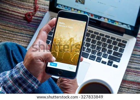 CHIANG MAI,THAILAND - OCT 16, 2015 : Person  Apple iPhone 6 plus with Twitter login on the screen. Twitter is a social media online service for microblogging and networking communication. - stock photo