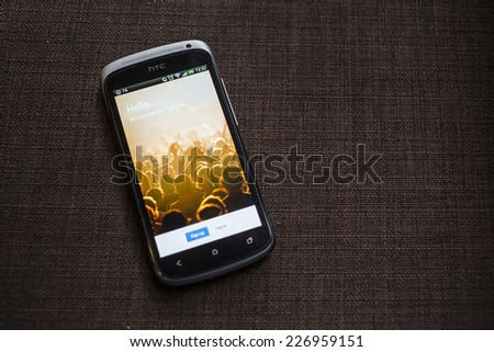 CHIANG MAI, THAILAND - OCTOBER 21, 2014: Log in Twitter application using Android smartphone. Twitter is largest and most popular social networking site in the world. - stock photo