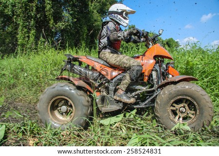 CHIANG MAI, THAILAND - OCTOBER 19 : Tourists riding ATV to nature adventure on dirt track on OCTOBER 19, 2014 in Chiang Mai, Thailand.  - stock photo