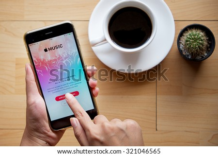 CHIANG MAI,THAILAND - SEP 16,2015 : A woman hand holding Apple music app showing on iPhone 6 plus. Apple Music is the new iTunes-based music streaming service that arrived on iPhone. - stock photo
