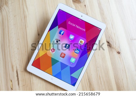 CHIANG MAI, THAILAND - SEPTEMBER 07, 2014: All of popular social media icons on tablet device screen wood background. - stock photo