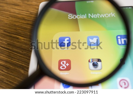 CHIANG MAI, THAILAND - SEPTEMBER 17, 2014: All of popular social media icons on tablet device screen with magnify glass. - stock photo