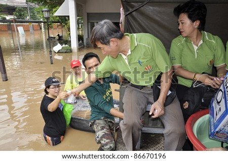CHIANG MAI THAILAND - SEPTEMBER 29 : Flooding in Chiangmai city.The team of government assistance for flood victims in the village on September 29,2011 in Chiangmai, Thailand - stock photo