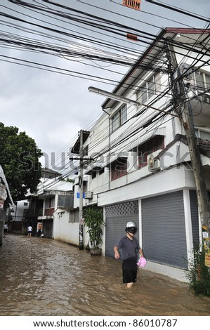 CHIANG MAI THAILAND - SEPTEMBER 28 : Flooding the Chiangmai city.Flooding of buildings near the Ping River on September 28,2011 in Chiangmai,Thailand - stock photo