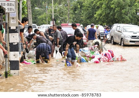 CHIANG MAI THAILAND - SEPTEMBER 28 : Flooding the Chiangmai city.People are starting to come together to sandbag the flood damage to a minimum on September 28,2011 in Chiangmai Thailand - stock photo