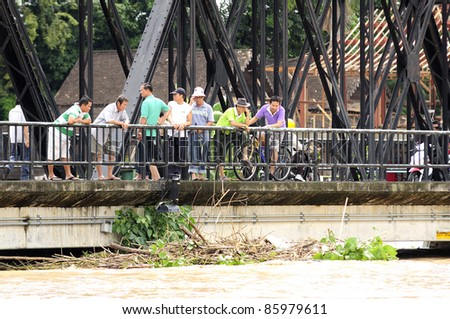 CHIANG MAI THAILAND - SEPTEMBER 28 : Flooding the Chiangmai city.Public interest and the effect of higher water levels every hour at bridge  on September 28,2011 in Chiangmai Thailand - stock photo