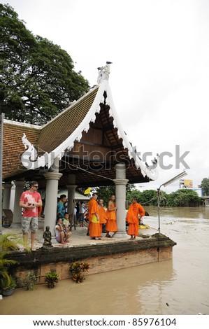 CHIANG MAI THAILAND - SEPTEMBER 28 : Flooding the Chiangmai city.Thai temples flooded religious buildings on September 28,2011 in Chiangmai Thailand - stock photo