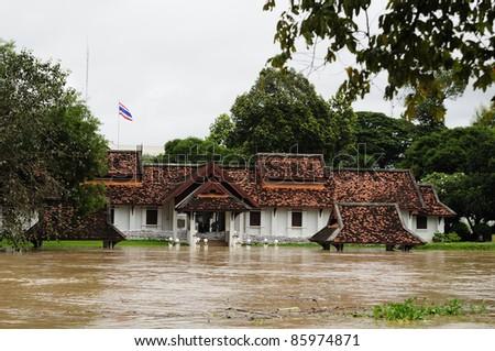 CHIANG MAI THAILAND - SEPTEMBER 28 : Flooding the Chiangmai city.The monuments are flood Kawila God on September 28,2011 in Chiangmai Thailand - stock photo