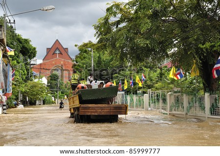 CHIANG MAI THAILAND - SEPTEMBER 28 : Flooding the Chiangmai city.Water from flooded streets and nearby buildings on September 28,2011 in Chiangmai,Thailand - stock photo
