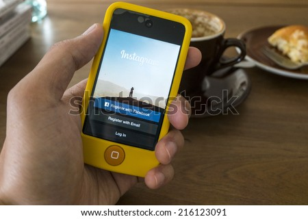 CHIANG MAI, THAILAND - SEPTEMBER 05, 2014: Instagram login screen application on iPod touch apple product with wood background. - stock photo