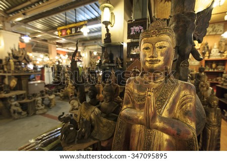CHIANG MAI THAILAND - 29 SEPTEMBER 2015 : Night Bazaar market ,Handicraft products of wood carving is a popular tourist to buy a souvenir, night market is open every day. - stock photo