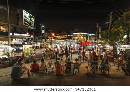 CHIANG MAI THAILAND - 29 SEPTEMBER 2015 : Night Bazaar market , one of the most popular night market in Chiang Mai. Tourists like shopping and dining , night market is open every day. - stock photo