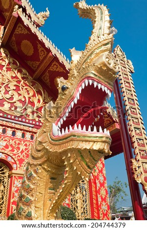 CHIANG RAI, THAILAND - FEBRUARY 13: Dragon sculpture at entrance to temple Klang Wiang, Chiang Rai, Thailand, February 13, 2014. Temple originated in 15th century - stock photo